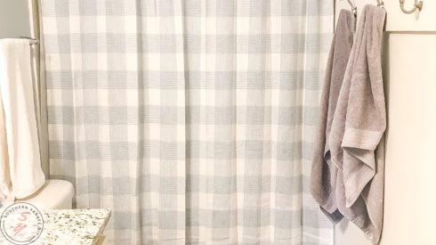 bathroom, bathroom makeover, bathroom renovation, spare bathroom, neutral decor, neutral bathroom, light paint colors, trim, board & batten, hooks, bathroom organization, bathroom shower curtain, tile flooring, diy bathroom renovation, diy bathroom hooks, storage, buffalo check decor, target, sherwin Williams, Valspar, light gray